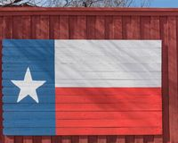 Texas flag pattern on wooden board texture. Vintage painted Lone Star State symbol texture on grunge wall fence. Room for text, copy space royalty free stock image