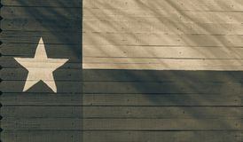 Texas flag pattern on wooden board texture. Vintage painted Lone Star State symbol texture on grunge wall fence. Room for text, copy space stock photography