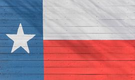 Texas flag pattern on wooden board texture. Vintage painted Lone Star State symbol texture on grunge wall fence. Room for text, copy space royalty free stock photography