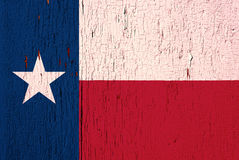 Texas flag on peeling paint. Texas State flag on the peeled, textured, aged paint background royalty free stock photography