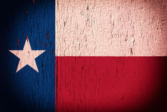 Texas flag on peeling paint. Flag of Texas State on the peeled, textured, cracked background stock photos