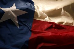 Texas flag. The Texas flag in shadow and vintage light, highlighting the flags single star stock image