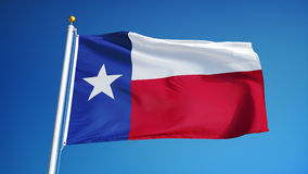Texas flag in slow motion seamlessly looped with alpha. Texas flag waving in slow motion against clean blue sky, seamlessly looped, close up, isolated on alpha stock video