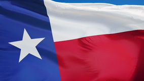 Texas flag in slow motion seamlessly looped with alpha. Texas flag waving in slow motion against clean blue sky, seamlessly looped, close up, isolated on alpha stock video footage
