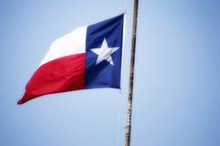Texas Flag. Texas State Flag against the clear blue sky royalty free stock photos