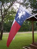 Texas flag. Sunrise hanging on side of lake house in Texas stock photos