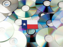 Texas flag on top of CD and DVD pile on white stock photo