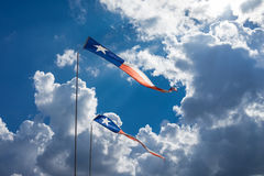 Texas Flags Blowing in the Wind. With Blue Sky and Clouds Royalty Free Stock Photography