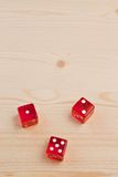 Texas gaming dice on light wood Royalty Free Stock Photos
