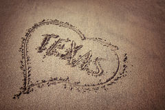 Texas and heart written on beach sand Royalty Free Stock Photo