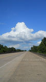 Texas Highway. With trees and sky with clouds stock photos