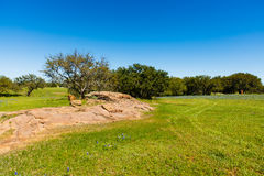 Texas Hill Country. Beautiful Texas Hill Country ranch with granite rock mound and oak trees on a sunny day Royalty Free Stock Photography