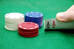 Texas Hold 'Em. Pair of aces and chips in Texas Hold 'Em poker game Stock Photo