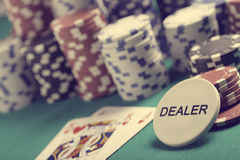 Texas hold'em. Casino poker chips with a dealer button Stock Images