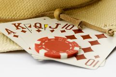 Texas Hold'em, Cards, Royal Flush, Poker. Texas Hold'em, an intense perfect use of a chip, a royal flush and a cowboy hat royalty free stock photography
