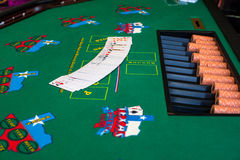 Texas hold 'em. French cards for Texas hold 'em ion casino table Royalty Free Stock Images