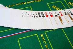 Texas hold 'em. French cards for Texas hold 'em ion casino table Royalty Free Stock Photo