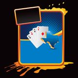 Texas hold em playing cards on orange splatter ban Stock Images