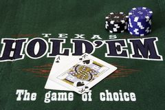 Texas hold em poker. A green mat with card and chips with poker written on it Stock Image