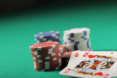 Texas hold'em poker. Stacks of chips and ace king Royalty Free Stock Photo