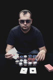 Texas Holdem Poker. Guy with glasses playing poker with two aces in his hands Stock Photos