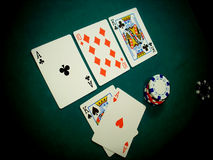 Texas Hold Flop Angled View. Angled view of a TEXAS HOLD EM hand. This stage of the game is known as THE FLOP, three cards dealt face up on the table (ACE KING Stock Photography