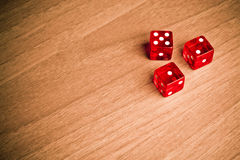 Texas holdem with dice. Detail of red dice on old wood with space for text Stock Image