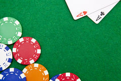 Texas holdem pocket aces on a casino table. Texas holdem pocket aces on casino table with copy space and chips Royalty Free Stock Image