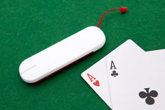 Texas holdem pocket aces on casino table. With internet stick connection Stock Photos