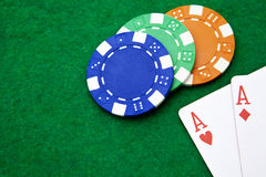 Texas holdem pocket aces on casino table Stock Images