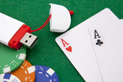 Texas holdem pocket aces on casino table. With internet stick connection Stock Images