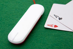 Texas holdem pocket aces, online. Texas holdem pocket aces on casino table with internet stick connection Stock Photography