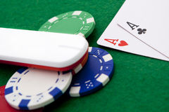 Texas holdem pocket aces, online. Texas holdem pocket aces on casino table with internet stick connection Royalty Free Stock Image