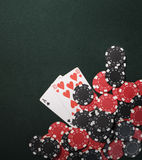 Texas holdem poker cards and Casino chips. Casino chips on a green background and texas holdem poker cards in Vegas Royalty Free Stock Photo