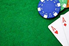 Texas holdem Taschenasse auf Kasinotabelle Lizenzfreie Stockfotografie