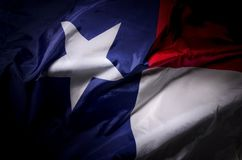 Texas Lone star. The Texas state flag waving in shadow Royalty Free Stock Images