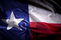 Texas Lone star. The Texas state flag waving in shadow Royalty Free Stock Photo