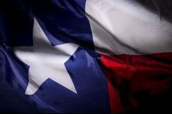 Texas Lone star. The Texas state flag waving in shadow Stock Photo