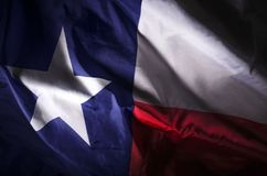 Texas Lone star. The Texas state flag waving in shadow Royalty Free Stock Photos