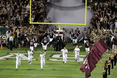 Texas A&M Aggies. Aggie yell leaders lead Texas A&M onto the field at Kyle Field in College Station Texas Stock Images