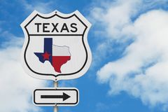 Texas map and state flag on a USA highway road sign. With sky background royalty free stock photo