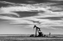 Texas Panhandle Skyline. One of many Pump Jacks used to extract crude oil for energy that dot the Northern Texas Landscape Royalty Free Stock Photography