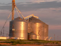 Texas Panhandle Sunrise. Sunrise on grain storage tanks in the west Texas panhandle Stock Image