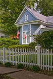 Texas pride. House with white picket fence and American and Texas flags Royalty Free Stock Photo