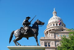 Texas Ranger. State of Texas Capitol building with a Texas Ranger guarding it at its feet royalty free stock image