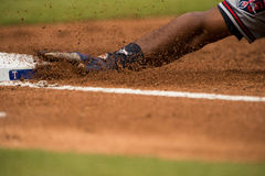 Texas Rangers base with hand sliding in room for copy text Stock Photo