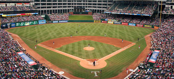 Texas Rangers Baseball Game. There was a big crowd at the recent Rangers and Rays baseball game. The players take their places as the game is about to begin Royalty Free Stock Image