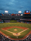 Texas Rangers Baseball Game at Night. There was a big crowd at the recent Rangers and Rays baseball game. The players take their places as the game is about to royalty free stock images