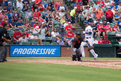 Texas Rangers player scoring in front of catcher Royalty Free Stock Photography
