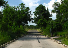 Texas road through creek bed Stock Photo